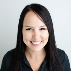 Orthodontic Assistant at Cardall Orthodontics: young woman with black hair wearing black scrubs.