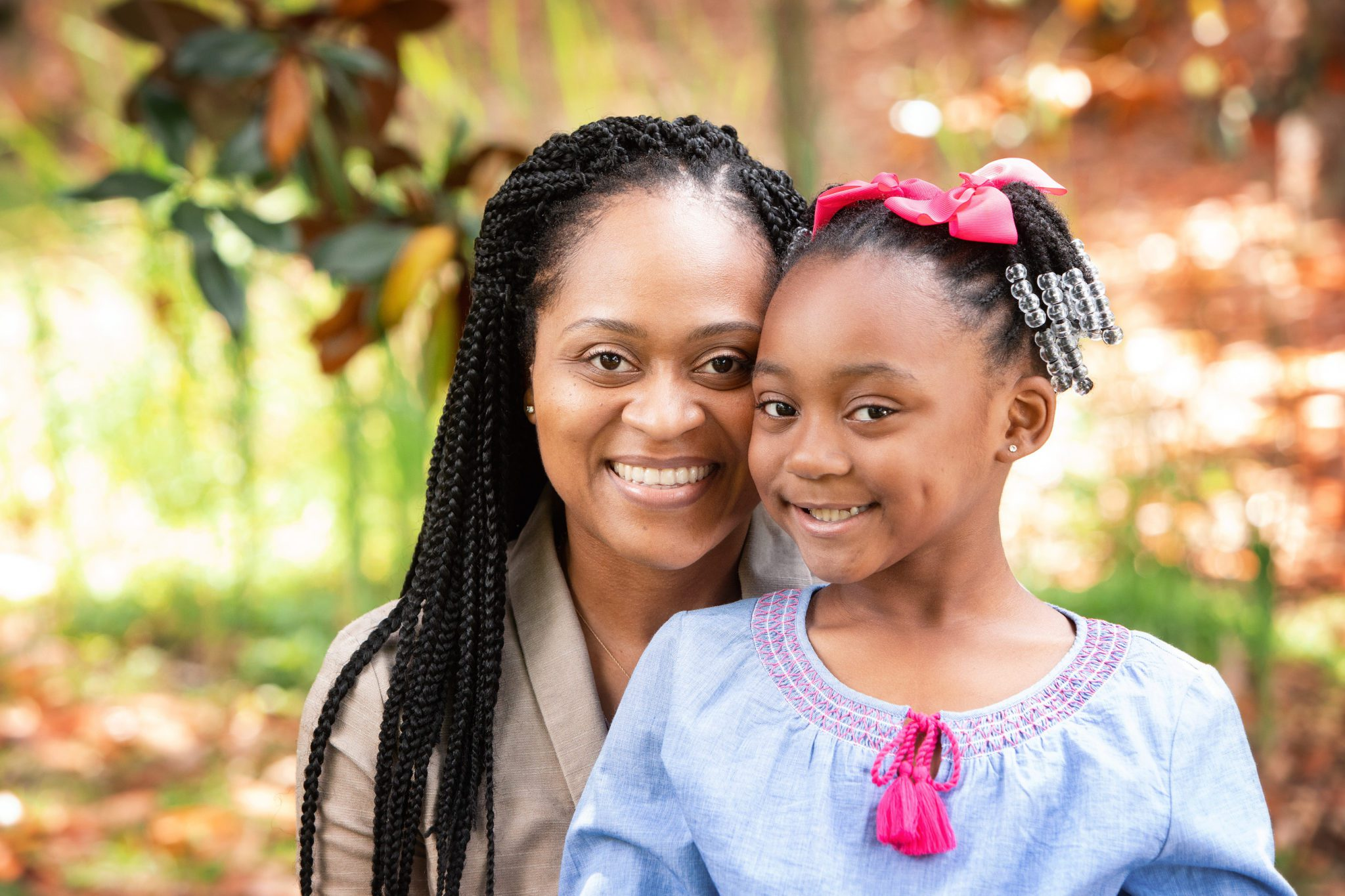 Young mother and child, white smiles, happy, mother and daughter, Spillers Orthodontics
