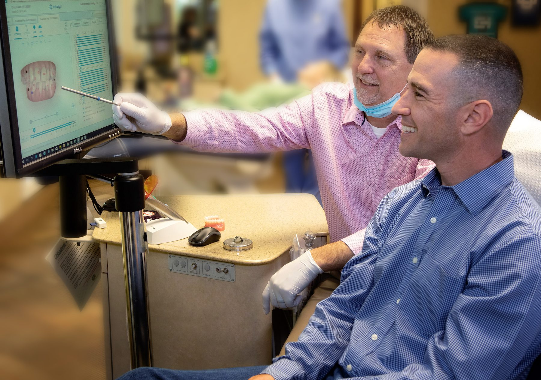 Dr. Spillers, Spillers Orthodontics, patient smiling, orthodontist teaching, pointing at screen, two men