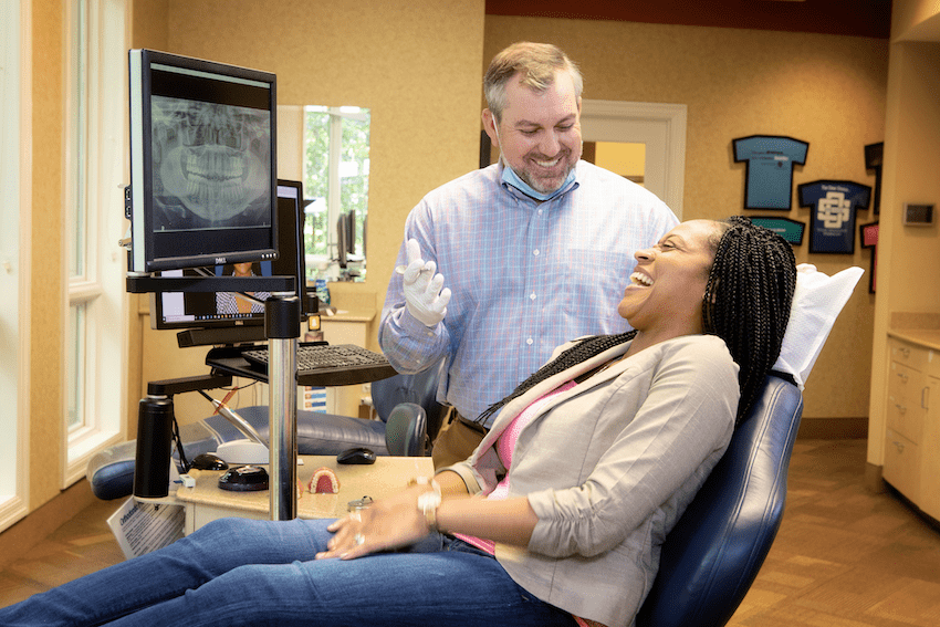 woman in exam chair with Dr. Gordon, Spillers Orthodontics, Effects of Diet Soda on Your Teeth