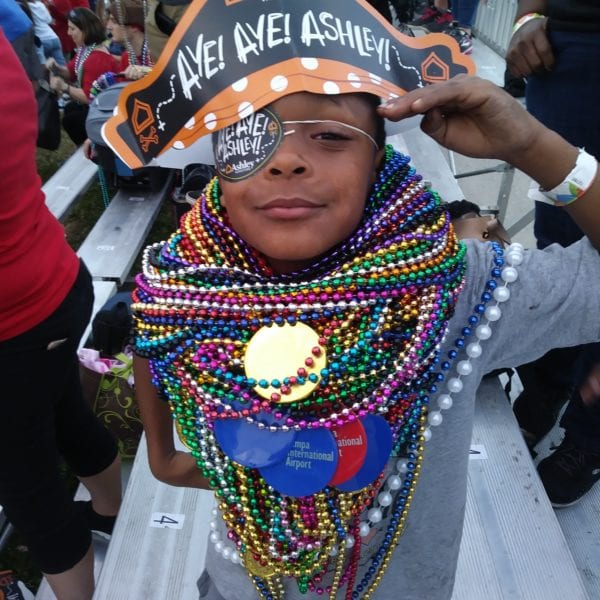 young child dressed as a pirate with beads