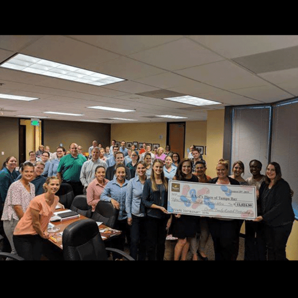Group presenting a large check