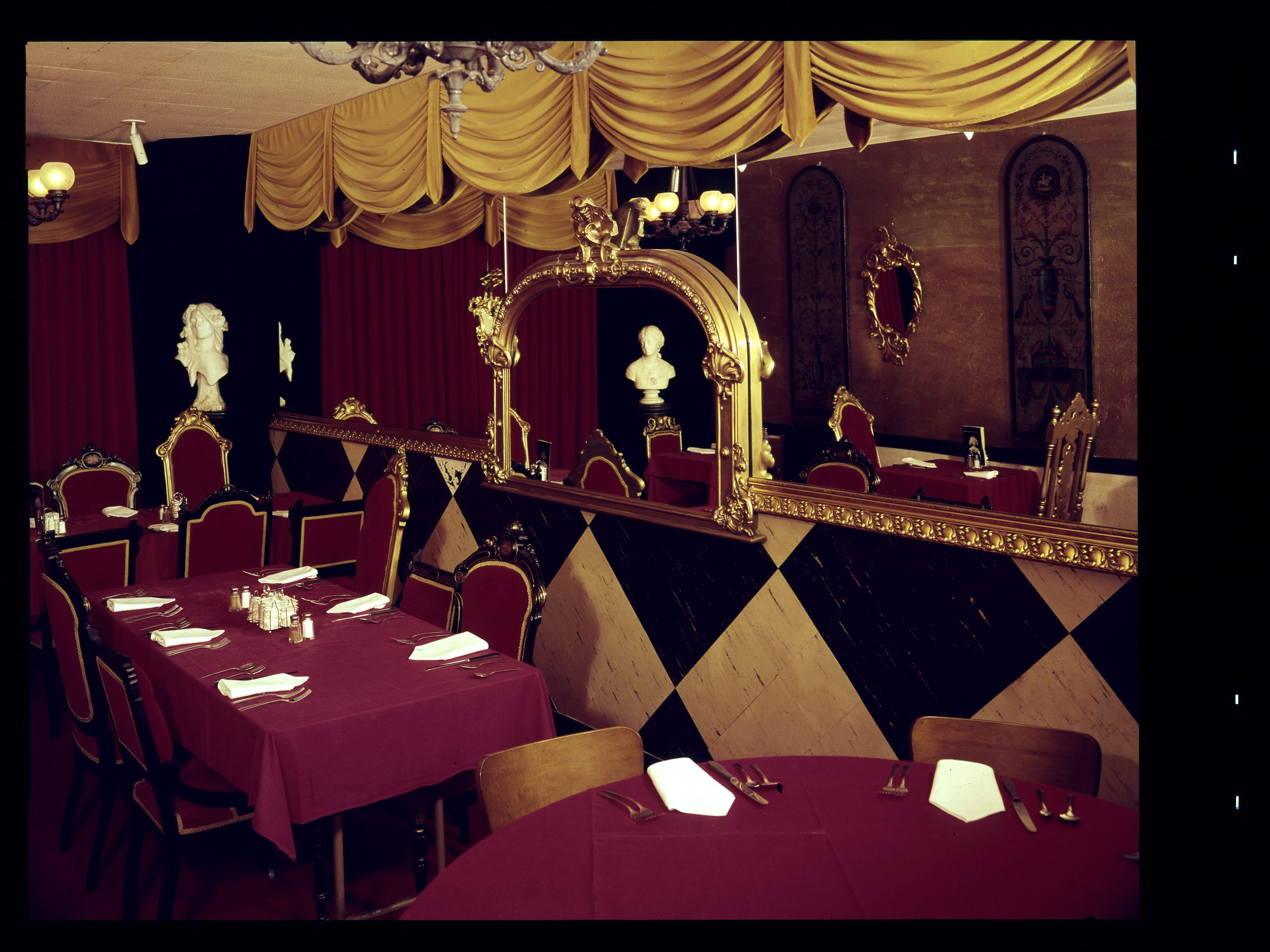 Fancy dining with garnet table cloths and gold drapes