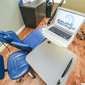 Melbourne office, Caudill & McNeight Orthodontics, exam chair and laptop