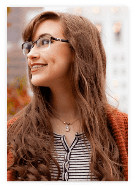 young woman in glasses smiling